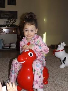 Sawyer on her new bouncing horse? donkey? something...