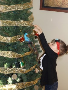 Sawyer decorating the tree in the sitting room...