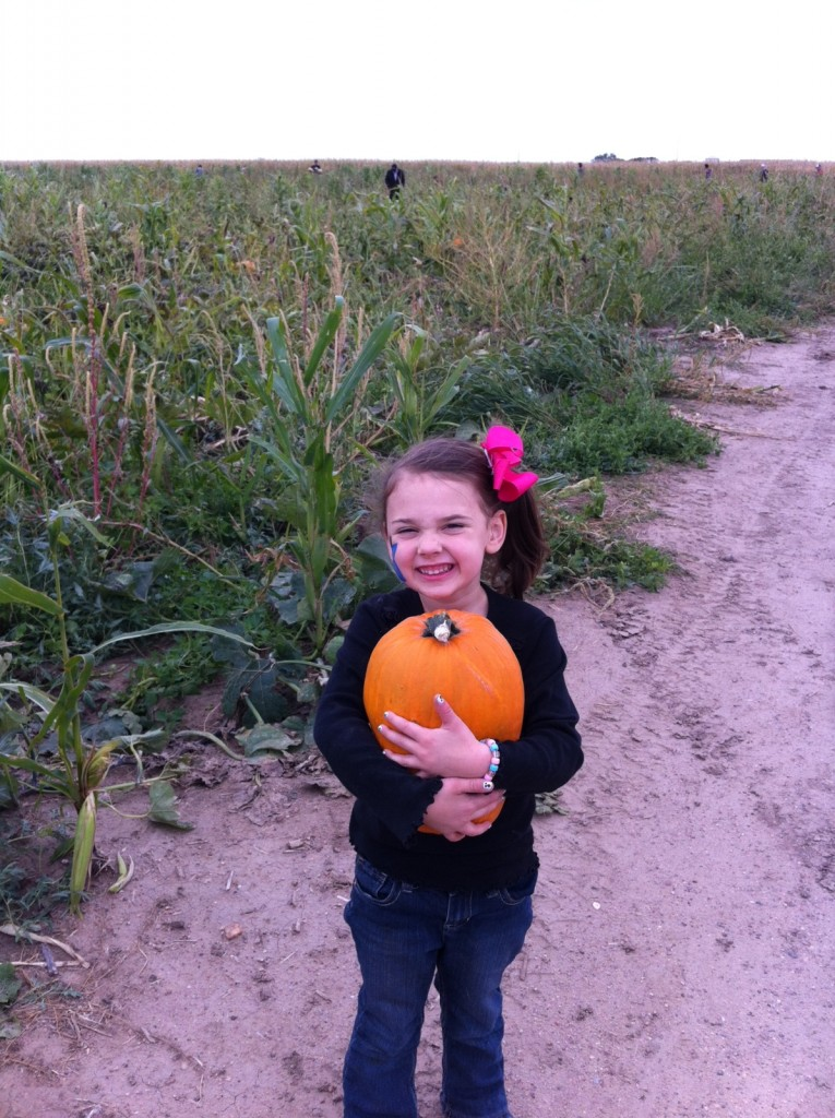 This girl could pick pumpkins all day...