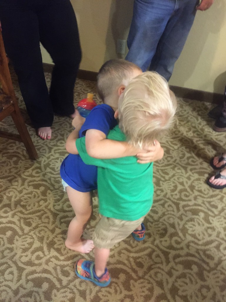 The boys hugging goodbye
