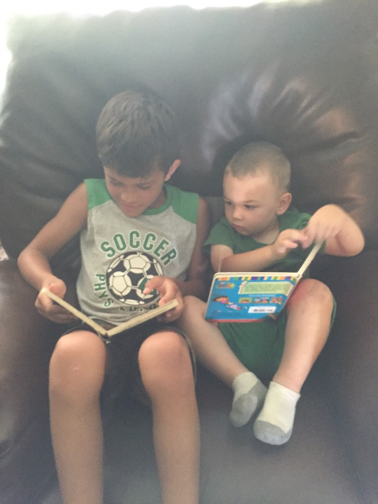 Reading with Tanner.  Wryder loved having a brother around!