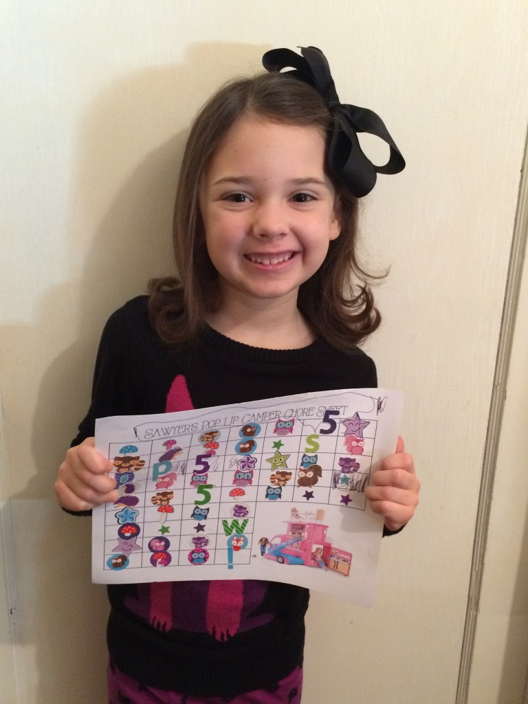 With her completed chore chart!